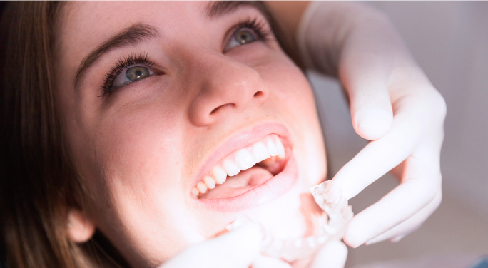 woman-smiling-at-the-dentist