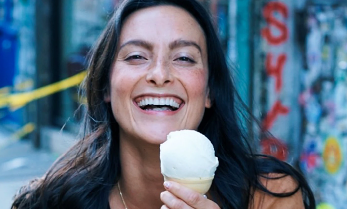 beautiful woman smiling with ice cream