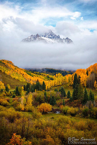 mt sneffels partially covered by clouds in the fall with aspens near ridgway colorado