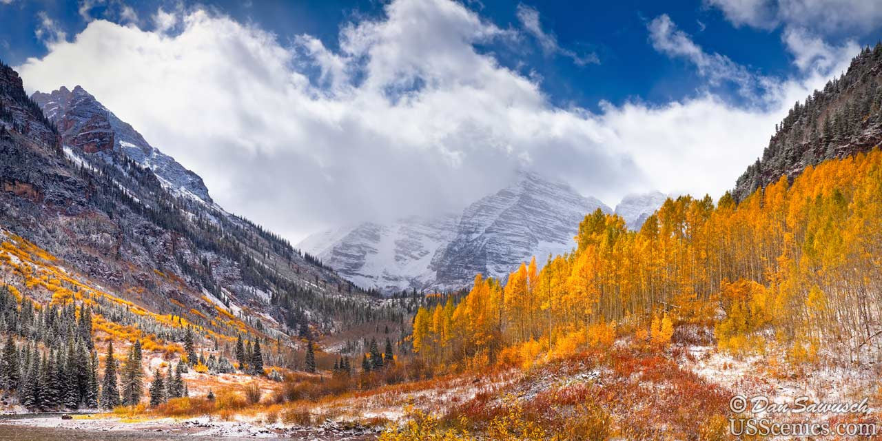 Snow capped maroon bells with yellow aspen trees