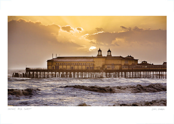 sunset over hastings pier poster