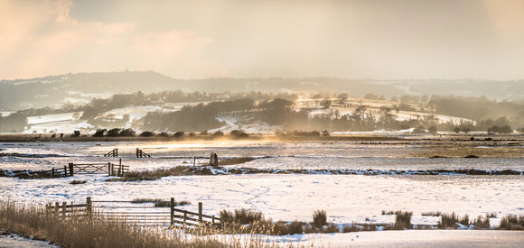 blowing snow on the fields at pett level