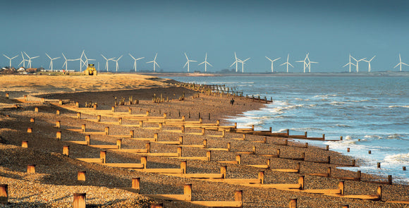 Low sun and Wind Turbines Winchelsea Beach