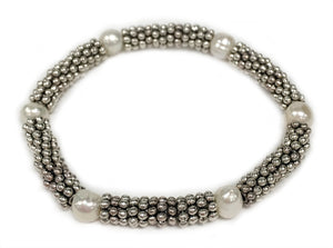 Tonle -  Creme ceramic accent bead on silvery stretch bracelet