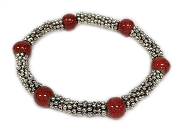 Tonle - Red ceramic accent bead on silvery stretch bracelet