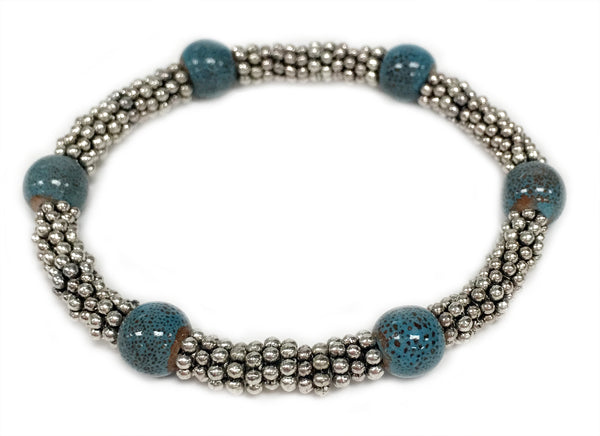 Tonle - Denim ceramic accent bead on silvery stretch bracelet