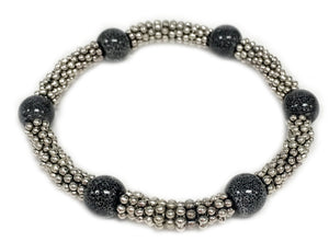 Tonle - Grey ceramic accent bead on silvery stretch bracelet