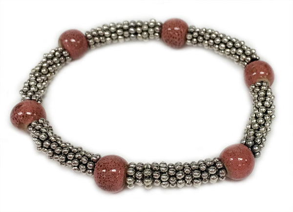 Tonle - Soft Pink ceramic accent bead on silvery stretch bracelet
