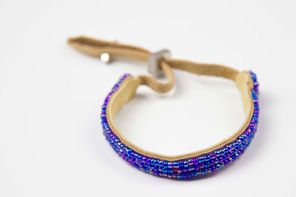 Zuri - Blue glass hand beaded w/leather backing & sterling silver pull closure