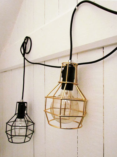 Black and Gold Cage Lamps Suspended