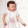 sleeping baby wearing aden and anais sleeping bag in pink medallion print