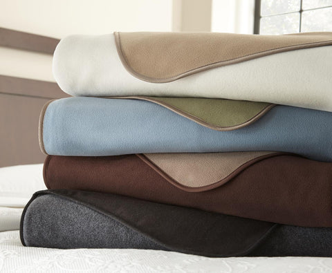 Stack of Mambe waterproof Furniture Covers in all colors available