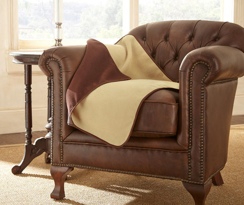 Chocolate khaki Mambe waterproof throw on upholstered chair