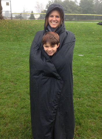 Mambe waterproof fleece Hooded Blanket - full length image showing parent and child wrapped up together..