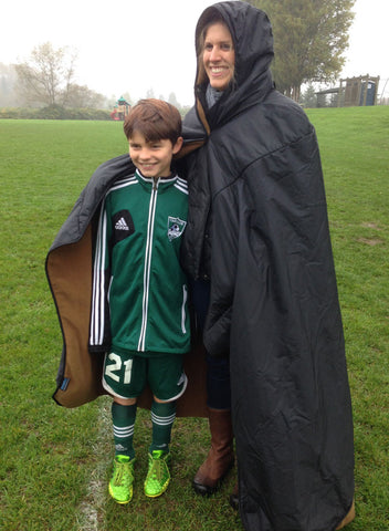 Mambe waterproof fleece Hooded Blanket - full length image showing parent and soccer player on the sidelines.