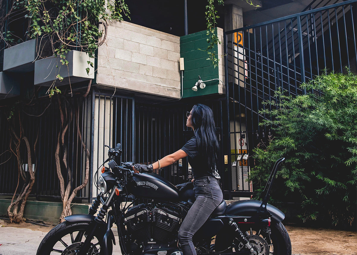 Ana Bribiesca in the urban jungle on her harley davidson