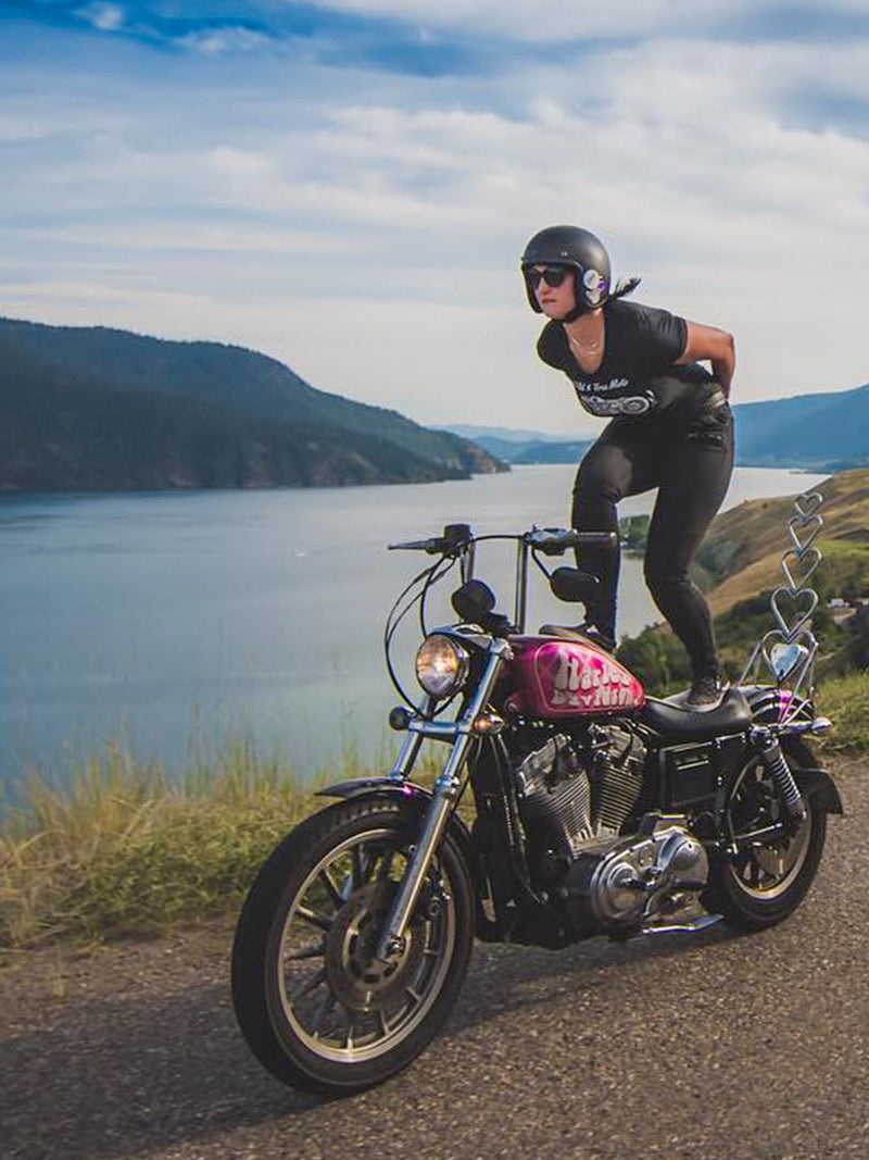 Ria moto surfing on her 883 sportster