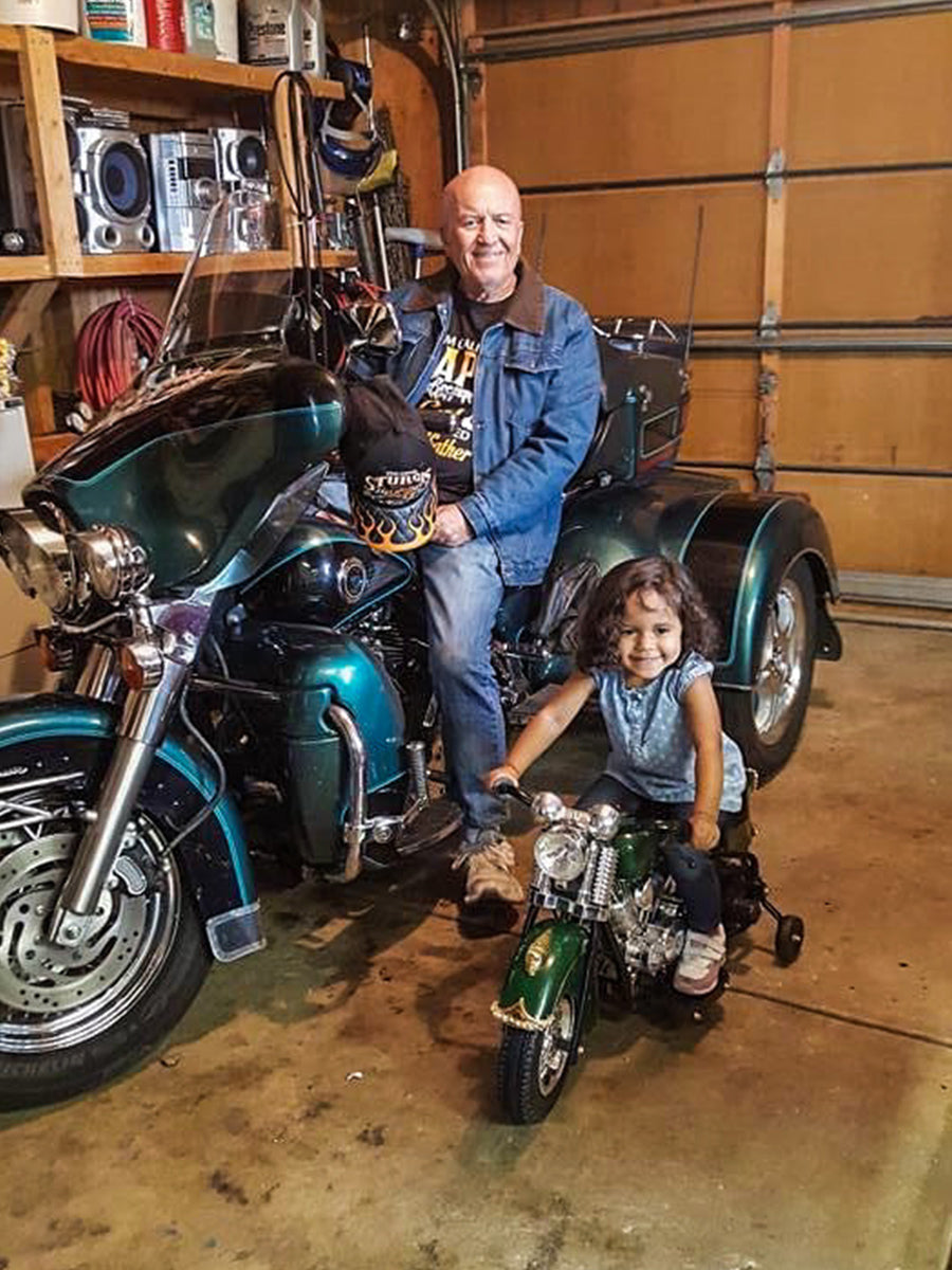 Grandfather and granddaughter sharing the love of motorcycles