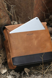 trip machine tan leather messenger bag