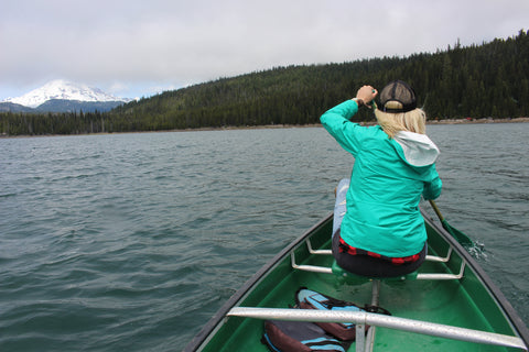 Outdoor travel adventures can include boat rides on lakes