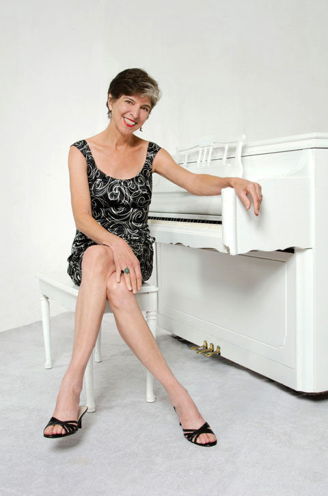 Marcia Ball sitting at her piano