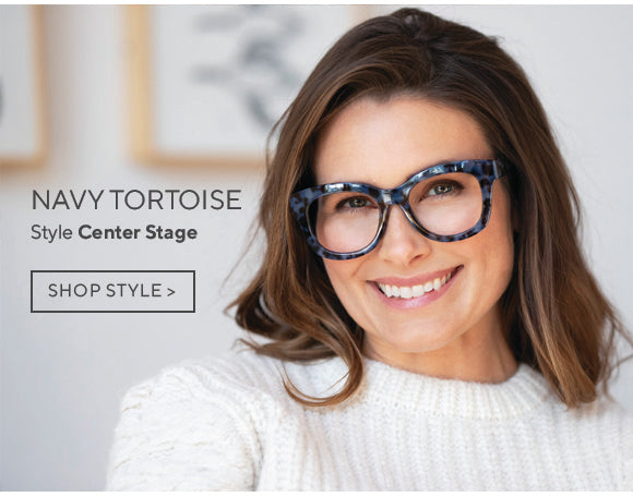 Brunette woman wearing Center Stage Focus blue light reading glasses in navy tortoise by Peepers