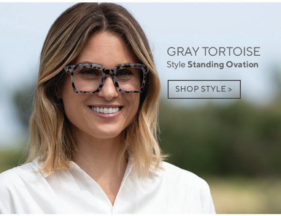 Woman wearing Standing Ovation gray tortoise oversized reading glasses by Peepers