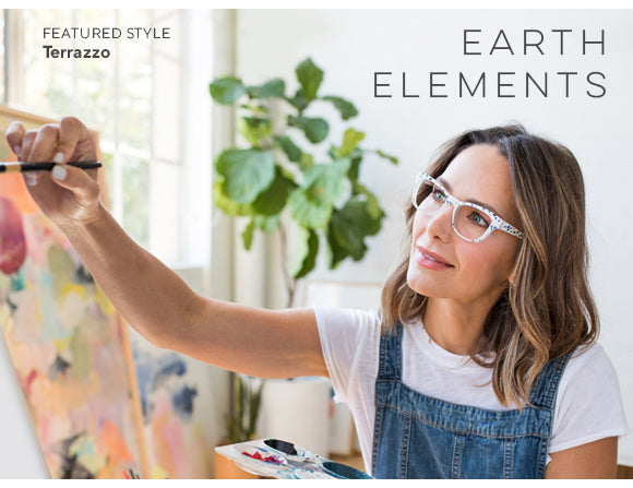 A woman painting on a canvas wearing Terrazzo blue light reading glasses by Peepers in their earth elements trend