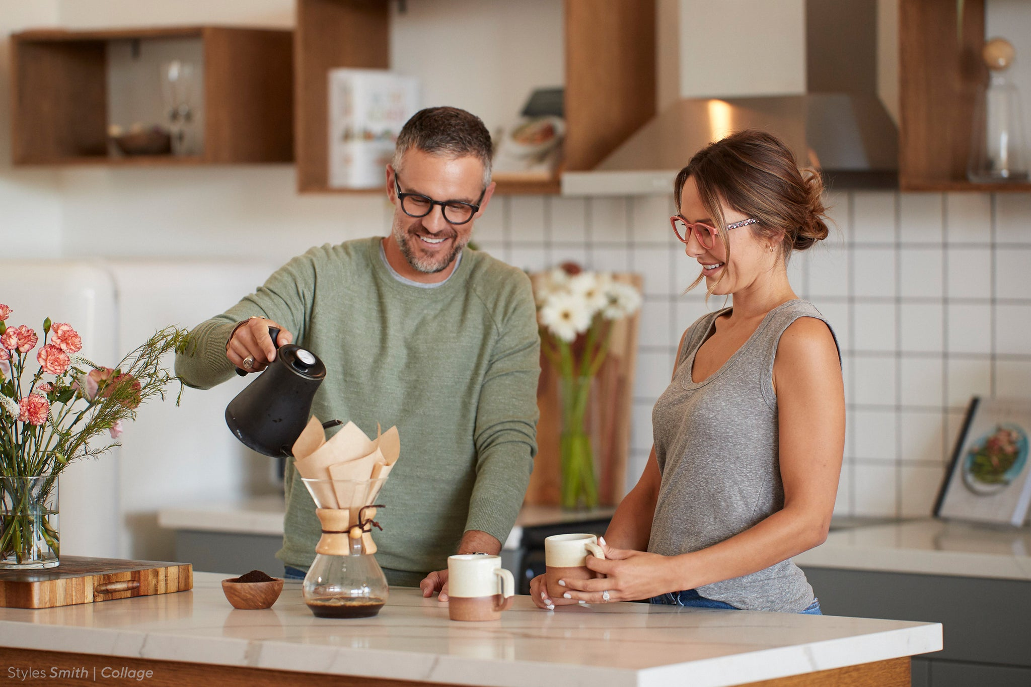 Man and woman brewing coffee in the kitchen wearing Peepers blue light glasses