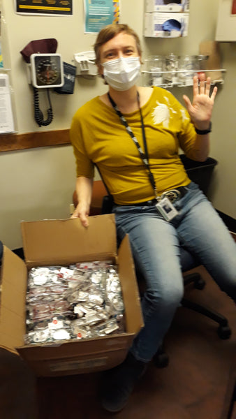 Donated Peepers reading glasses received by Heartland Alliance Health