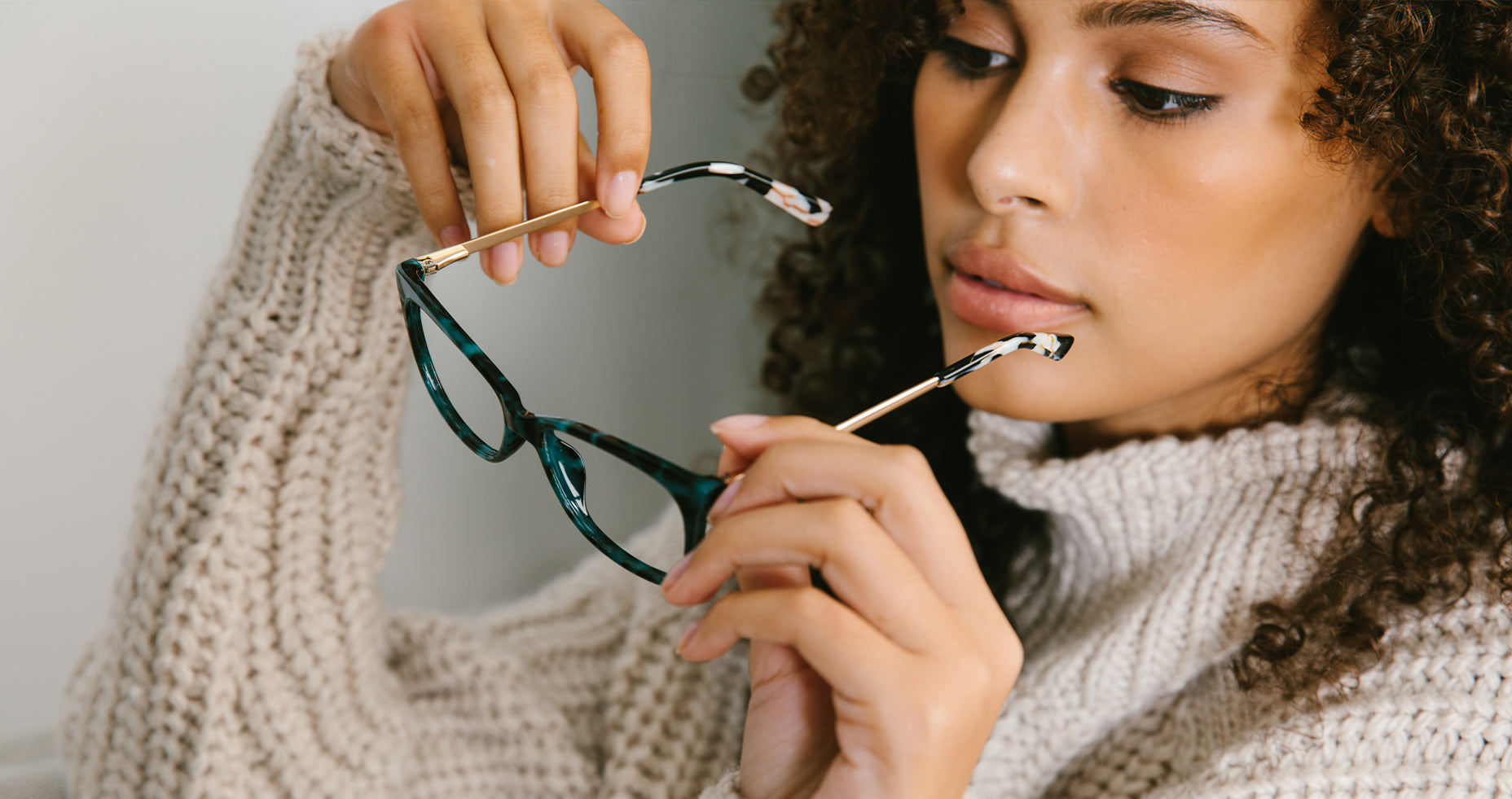 Woman looking at glasses