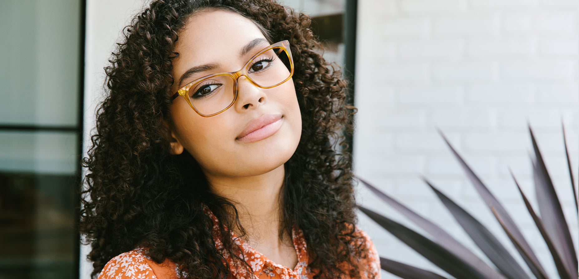 Woman wearing Peepers See The Beauty blue light glasses