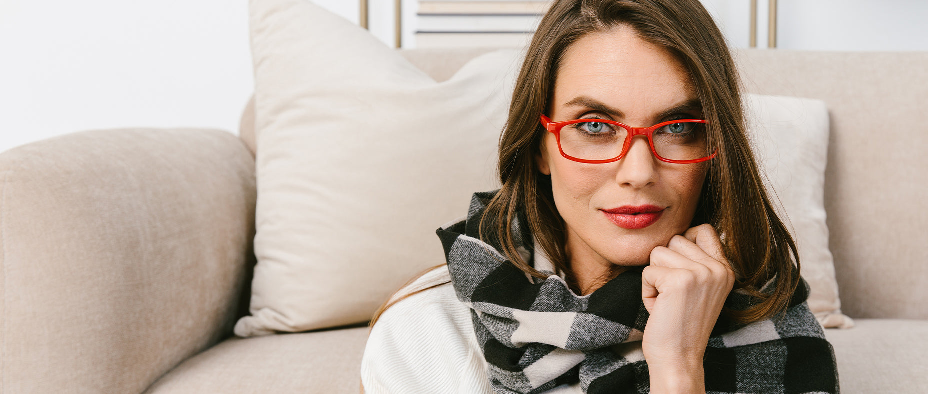 Woman with blue eyes wearing red Peepers glasses