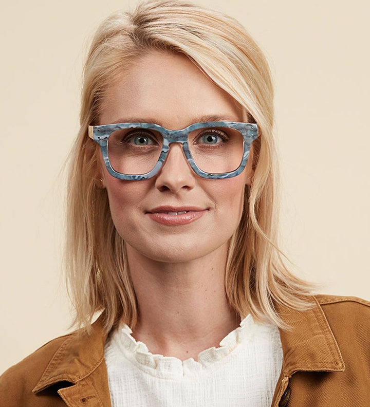 Female model wearing wide frames
