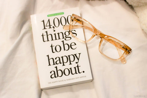 14,000 things to be happy about book with Peepers Venice crystal tan reading glasses