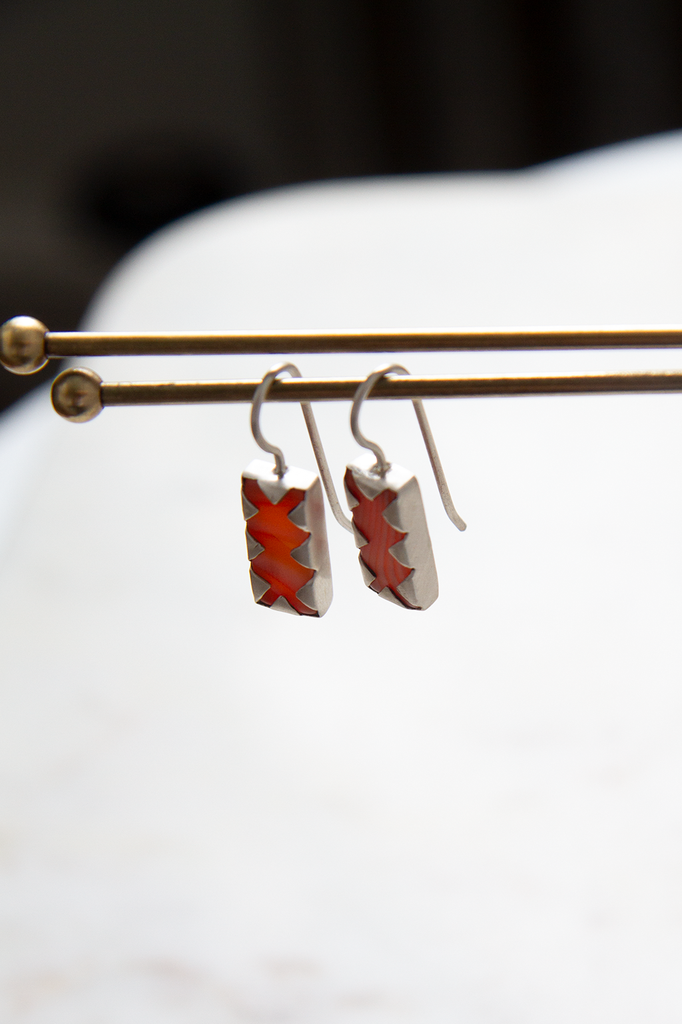 Rectangular Stone with Fold Over Claw Setting in Carnelian