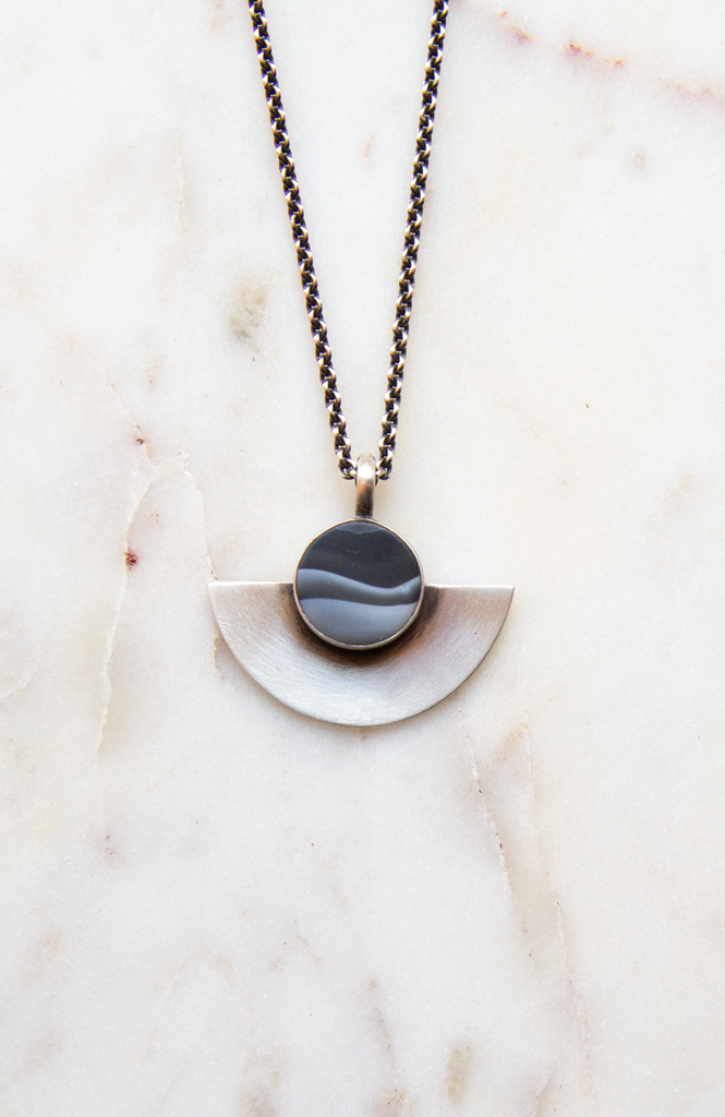 Matte stone with half moon pendant
