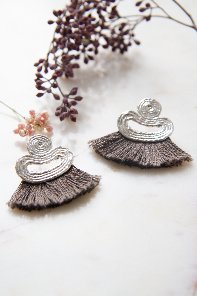 Silver Studs with Pewter Tassle