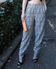 White & Black Geometrical Print Trousers by FRNCH