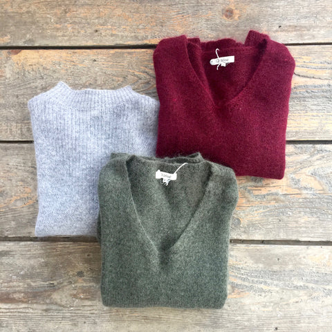 Three wool-blend sweaters