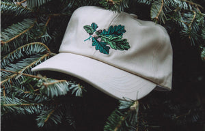 Acorn dad hat by Antler & Woods in a pine tree
