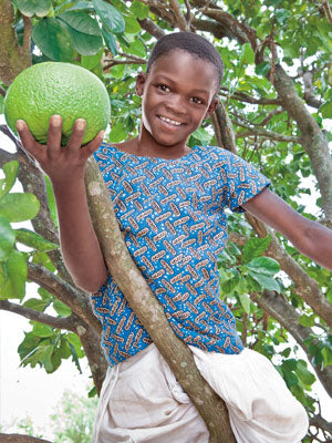 Barbra, age 11, likes to climb the trees and eat the fruit.