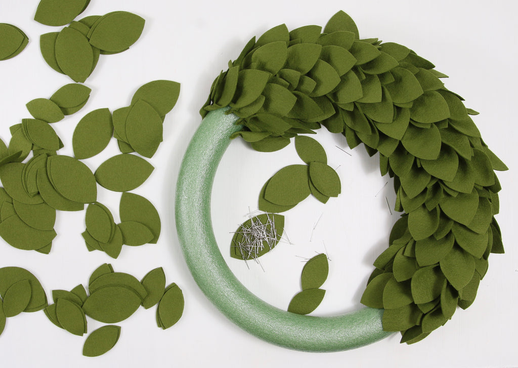Craft a wreath from felt.