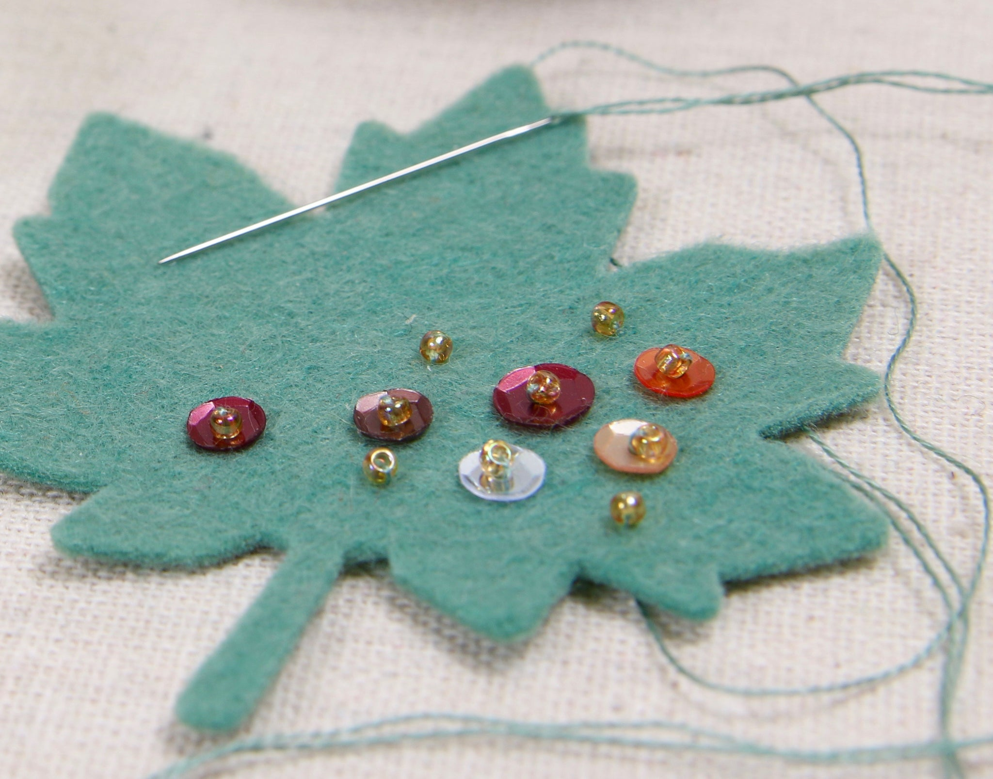 sewing sequins on felt