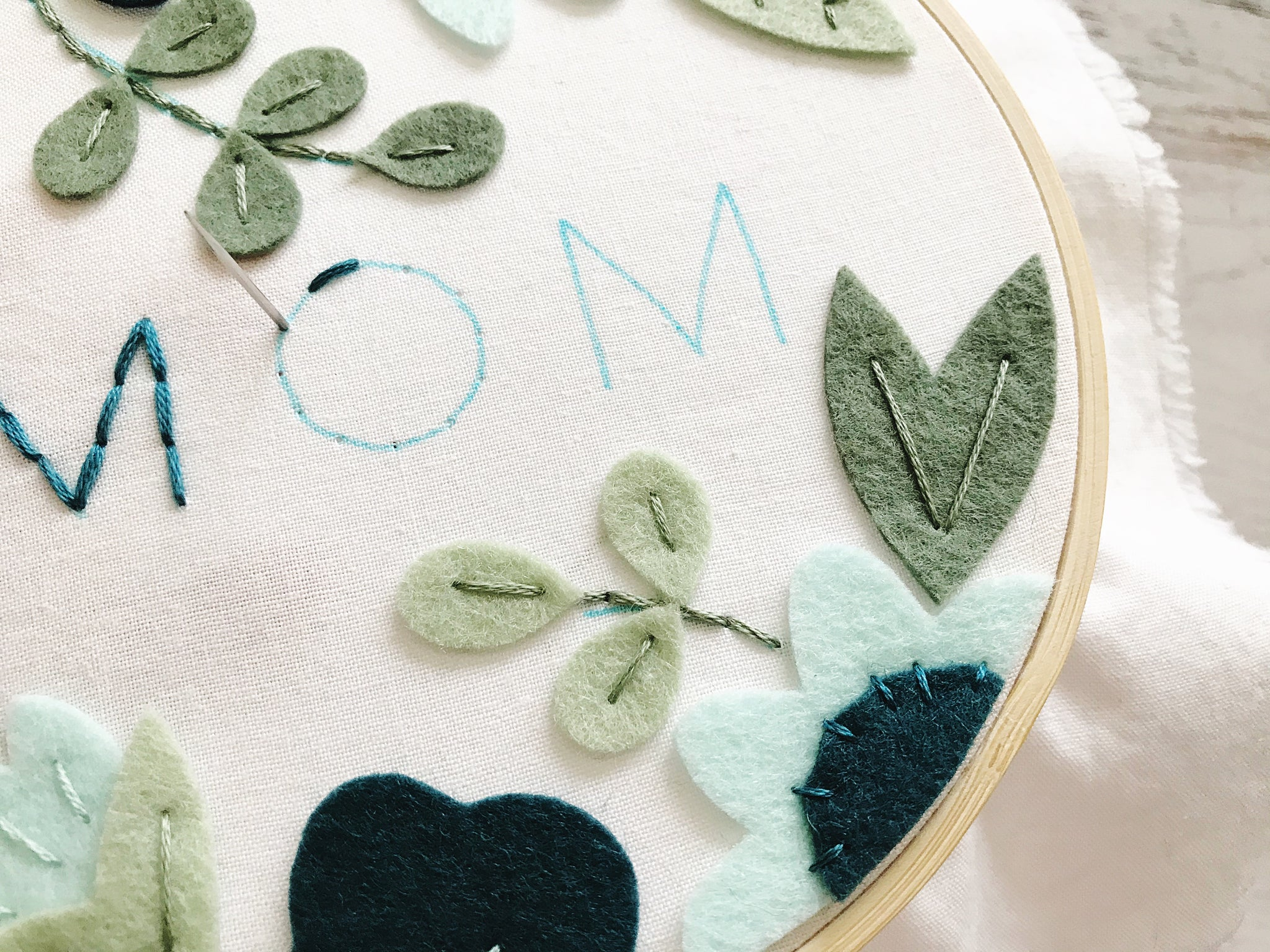 Stitching text onto the hoop
