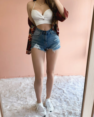 MOVING ON DISTRESSED HIGH WAISTED SHORTS