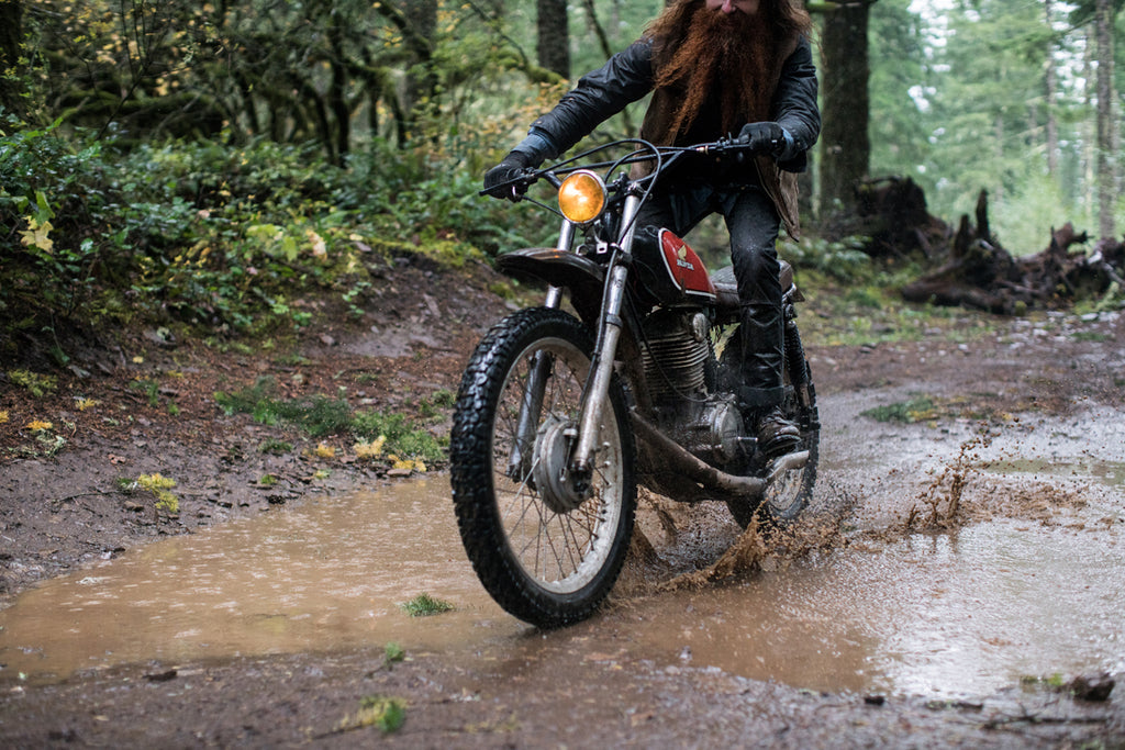 riding through puddles, waxed canvas, vintage honda, honda xl, xl350, red clouds collective, dirt bike