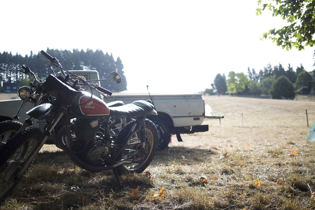 Red clouds collective. Camping, Adventuring, Build motorcycles, vintage triumphs, ride horses and old dirt bikes. Go riding motorcycles in the great northwest in waxed canvas work pants, with the magnetic beer koozie, shop apron, waxed canvas tool roll, selvedge denim, wool, veg tan leather. All handmade in portland Oregon by craftsman with a rugged heritage style.