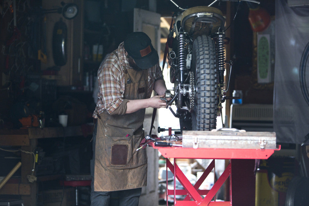 red clouds collective build motorcycles, vintage triumphs, and old dirtbikes, to go riding motorcycles in the great northwest in waxed canvas work pants, selvedge denim, wool, veg tan leather. All handmade in portland oregon by craftsman with a rugged heritage style