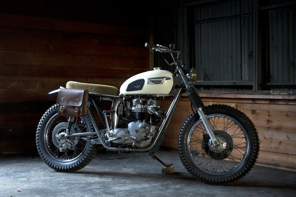 red clouds collective build motorcycles, vintage triumphs, and old dirtbikes, to go riding motorcycles in the great northwest in waxed canvas work pants, magnetic beer koozie, shop apron, waxed canvas tool roll, selvedge denim, wool, veg tan leather. All handmade in portland oregon by craftsman with a rugged heritage style